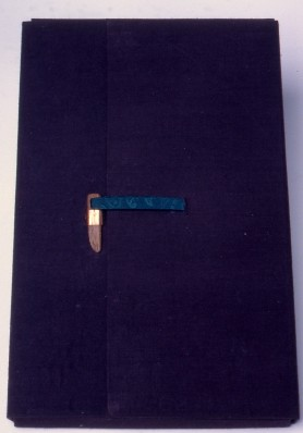 "6""X9""X1.50"". There were so many notes and memorabilia give to me to add to the book that I decided to include a portfolio to hold everything. The cover is of blue silk over thin book boards. The latch is hand carved walnut inserted into a brass clasp, the tie of a bit of painted silk."